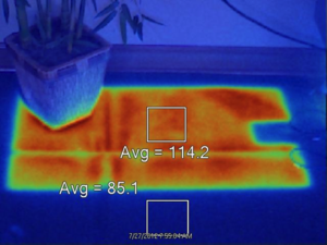 Thermal image depicting trapped heat under mat placed on the floor for 30 minutes.