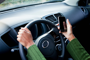 WarmlyYours encourages you  to break the distracted driving habit with the Red Thumb Reminder.