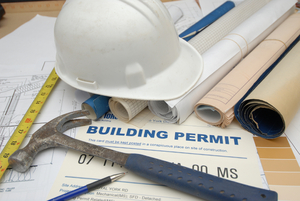 Building permit and materials for new home construction
