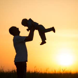Father lifting child in the air