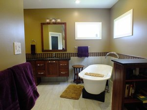Radiant floor heating warms the cold tile in a newly remodeled master bathroom suite