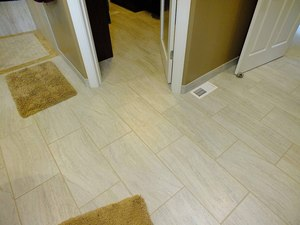 Porcelain tile in the master bath suite became warm and inviting with electric radiant floor heating