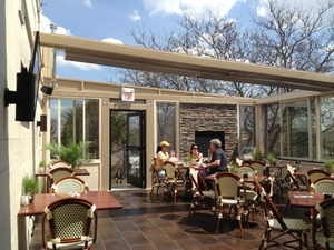 The retractable glass roof created a beautiful indoor-outdoor dining area, but heat loss is a real problem. The WarmlyYours TempZone floor heating system  helps keep the room warm year-round.