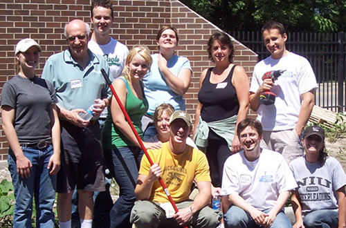 WarmlyYours Employees help out with local housing at HomeAid